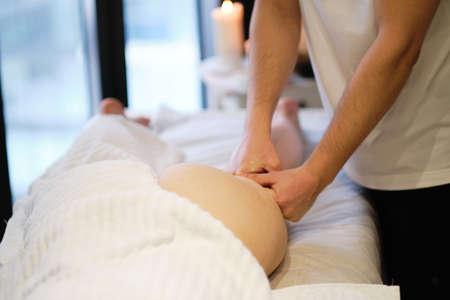 masseur makes anticellulite massage young woman in the spa salon. Body care concept. Special anticellulite treatment. Foto de archivo