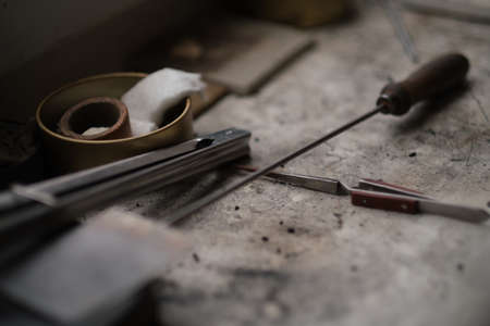 Still life of goldsmiths tools. realistic photograph of a jewelers workplace Фото со стока