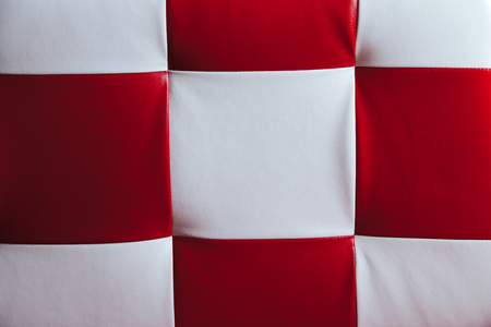 leatherette: Texture of leatherette with red and white squares