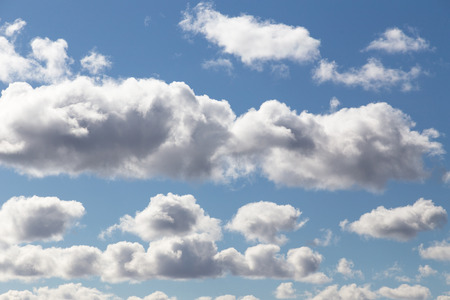 Fluffy clouds under the blue sky float