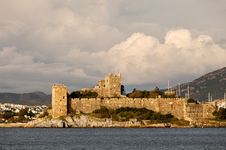 castle rock: Bodrum Castle with dramatic clouds Editorial