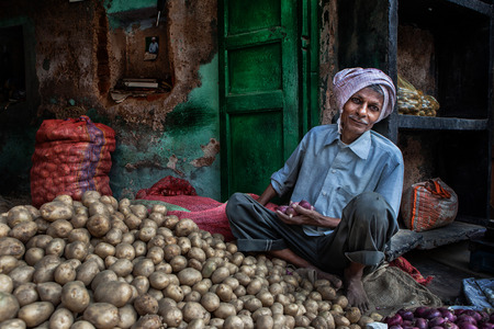 grocer: AGRA,INDIA - 23032013 : Grocery in Agra streets.There are many grocery in the streets of Agra,and this unidentified grocer sells potatoes and onions. Editorial