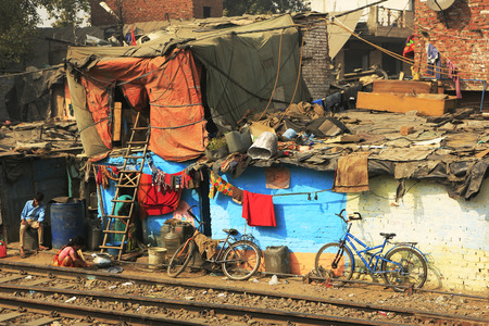 agglomeration: Delhi,India - November 13,2014 : Ghetto and slums in Delhi India.These unidentified people live in  avery  difficult conditions on the ghettos of the city. Editorial