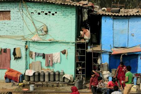slums: Delhi,India - November 13,2014 : Ghetto and slums in Delhi India.These unidentified people live in  avery  difficult conditions on the ghettos of the city. Editorial