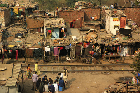 unplanned: Delhi,India - November 13,2014 : Ghetto and slums in Delhi India.These unidentified people live in  avery  difficult conditions on the ghettos of the city. Editorial