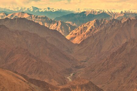 wide angle view of a rocky mountains and valley in ladakh