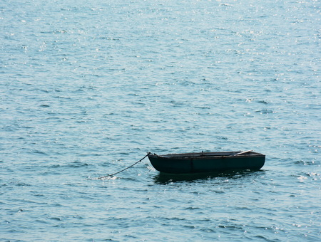 A wooden boat drifting in the sea