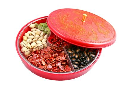 Chinese candy box is used for Chinese New Year, it consists different kinds of candies, chocolate coins, melon seeds, sugar preserved dried fruits or even dried vegetables. photo