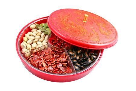 dried vegetables: Cuadro de caramelo chino se utiliza para el a�o nuevo chino, est� formado por diferentes tipos de caramelos, monedas de chocolate, semillas de mel�n, frutos secos de az�car conserva o legumbres secas incluso.