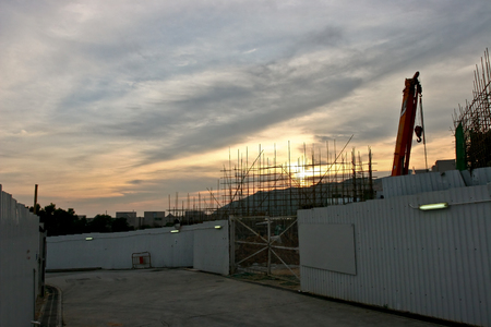 Building under construction with sunset
