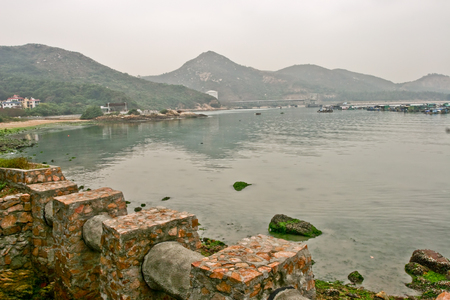 quite: Sea with stone and mountain