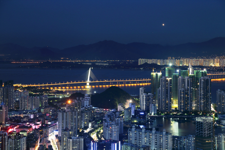Nightscape of the dusk in the coastal city of Shenzhen Bay Stock Photo