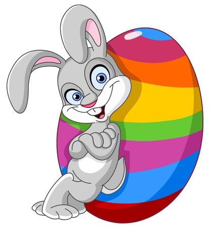 cartoon bunny: Happy bunny appoggi� un grande uovo di Pasqua