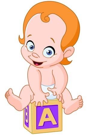 Happy baby assis sur un cube alphabet