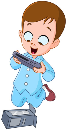 Happy kid wearing pajama and holding his video game console Christmas gift
