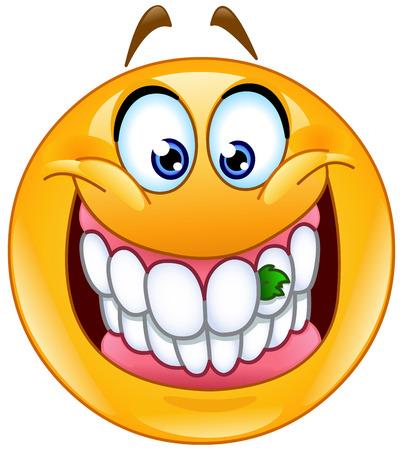 perejil: emoticono sonriente con el alimento atrapado entre sus dientes, algo en sus dientes.