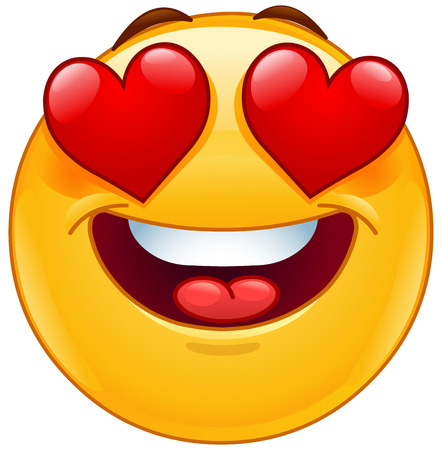 Smiling emoticon face with hearts instead of eyes as an expression of love