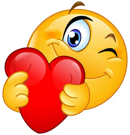Knipogende emoticon die een rood hart knuffelt
