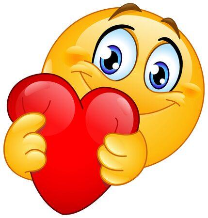Glückliches Emoji-Emoticon, das ein rotes Herz umarmt