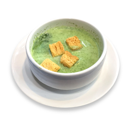 potage: Vegetable soup, green with bread on white background