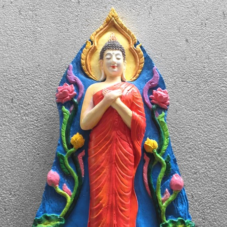 paper sculpture: Portrait of a buddha statue with background.