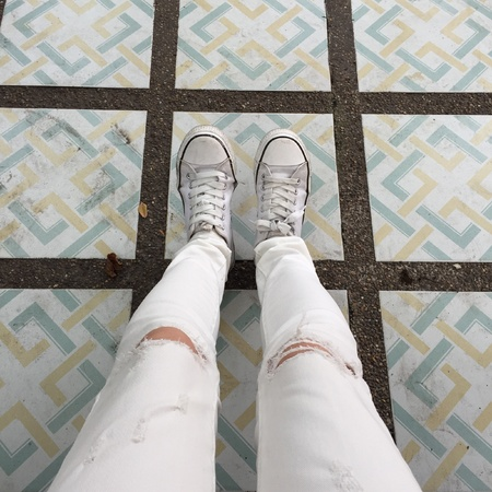 White Sneakers shoes walking on ground