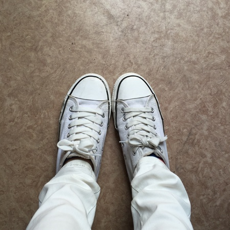 denim jeans: White Sneakers shoes walking on ground