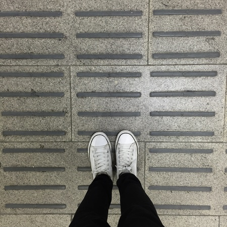 trendy: White Sneakers shoes walking on ground