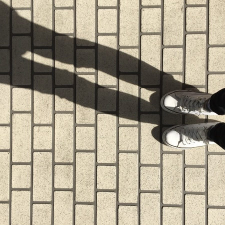 jeans: White Sneakers shoes walking on ground