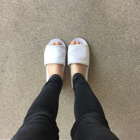close: Close up of a womans white Fluffy slippers Stock Photo