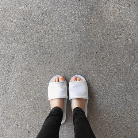 Close up of a womans white Fluffy slippers Stock Photo