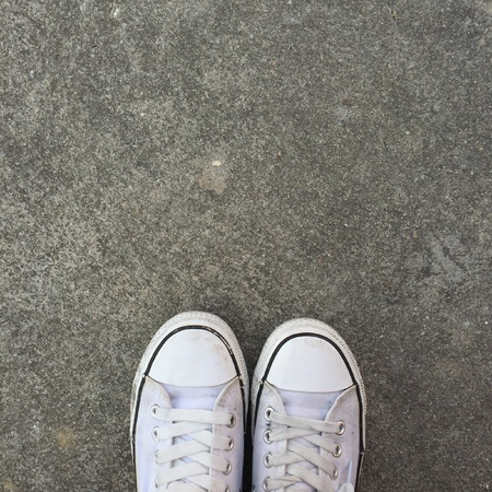 up: White Sneakers shoes walking on ground