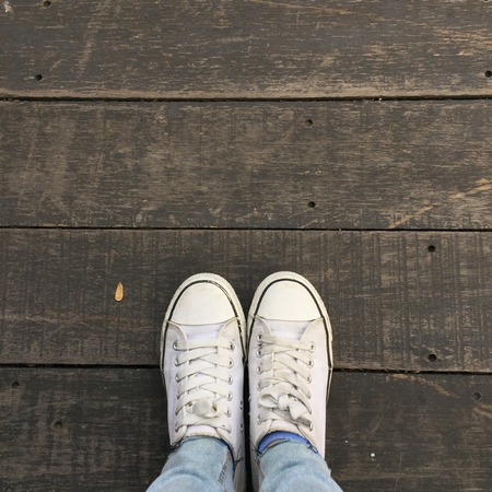 Fashion hipster cool woman with white sneakers, soft vintage toned colors great for any use.