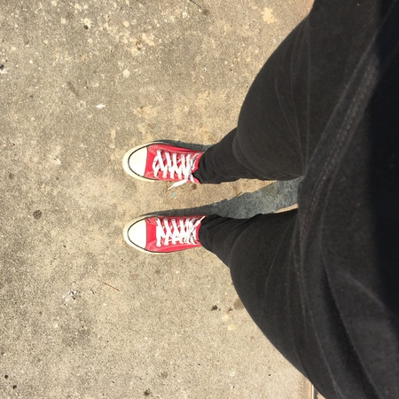 standpoint: Feet From Above Concept, Teenage Person in Red Sneakers Standing on Background Great For Any Use.