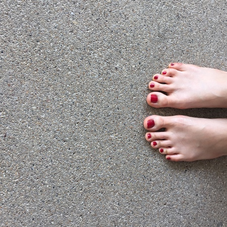 painted toes: Bare feet on floor great for any use.