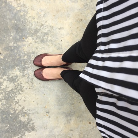 black shoes: Womens legs in black shoes. Bright black shoes and bag. Black jean. Street style. Business casual look great for any use.