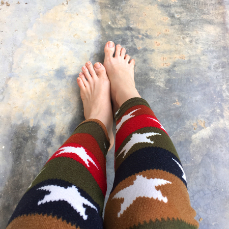 legging: Woman feet closeup of girl relaxing on ground or floor. top view great for any use.