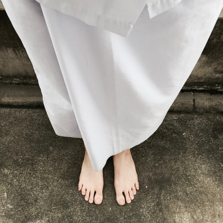 morals: Woman Buddhist Walking on Street or Ground for Relaxation and Meditation Great For Any Use.
