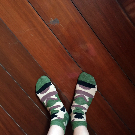 soldiers: Selfie Feet Wearing Camouflage socks on Wooden Floor background Great For Any Use.
