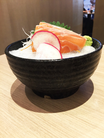 freshwater fish: Salmon Sashimi - Japanese Food on Ice in Bowl Set on a Wooden Table Background Great For Any Use.