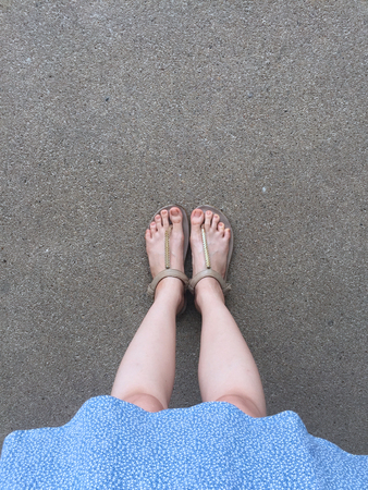 Female Feet Wear Sandals and Blue Dress on the Street Great For Any Use.