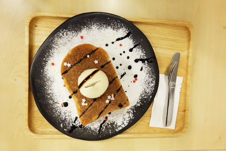 Vanilla Ice Cream Toast Bread with Icing Sugar on Wooden Table Great For Any Use.