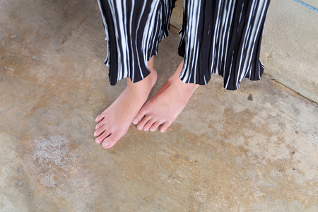 Barefeet Selfie in Straight Pants Standing on Concrete Background Great For Any Use.