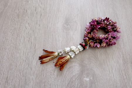 Close Up Dried Jasmine Garland Isolated on Wooden Floor Background Great For Any Use.