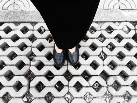 skirts: Close Up on Womans Feet Wearing Black Sandals & Dress, Standing Commemorate on the Street Great For Any Use. Stock Photo