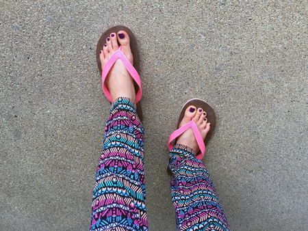 Sandal, Close Up on Girls Violet Nail and Feet Wearing Pink Sandals on the Street Background Great For Any Use.