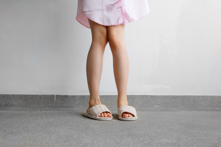 Pink Sleeping Suit and Slippers, Close Up of Woman's Pink Checkered Slippers Standing on Floor Background Great for Any Use.