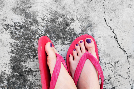 Nails Pedicure. Selfie Woman's Sandals Feet with Violet Nail Pedicure of Paint on Cement Background Great for Any Use.