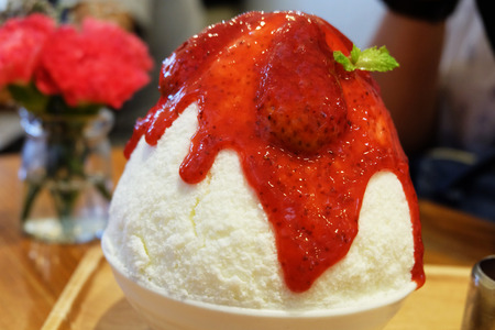 Strawberry Sauce and Cheesecake Shaved Ice Dessert Serving with Syrup on Wooden Salver Background Great for Any Use.