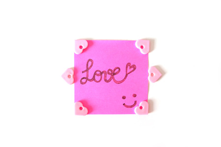 Drawn Smile Face with Love Word on Pink Sticker Paper Note on a White Background Great for Any Use.